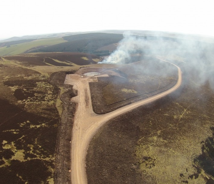 Road to T 20 and T21 with heather burning in-between. April 2015. Picture courtesy Community Windpower  Ltd